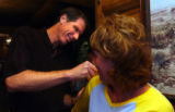 (Denver, Colo., June 24, 2004)  Kiki Vandeweghe signs the shirt of Denver Nuggets fan, Ellie...