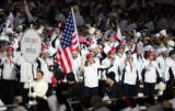 The U.S. Olympic Team was led into the Stadio Olimpico by five-time Olympian Chris Witty (center,...