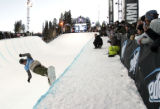 Scotty lago makes his way down the pipeduring practice before the snowboard superpipe finals  at...
