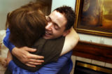 (Vernal, Utah) Jonathan Swain, 21, hugs Amber's mother, Janice Van Tassell, after he and Amber got...