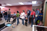 Aurora residents wait in line in the office of Animal Control at 15750 E. 32nd Tuesday morning...