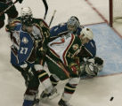 Battle at the net, in the first period, Avs' Ossi Vaananen #27,(roster)  Wild's #25 Randy...