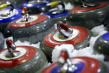 Curling stones sit on ice for a couple of hours to bring them down to the correct temperature for...