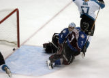 (DENVER, Colo., May 4,2004) Colorado Avalanche goalie David Aebischer is scored on by San Jose...