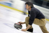 Broadmoor Curling Club member BJ Strohl (cq) of Colorado Springs delivers a stone during league...