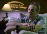 Kenny Wallace, on the couch before filming begins. Furniture Row Racing becomes a participant in...