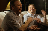 Kenny Wallace, LEFT, reacts during rehearsals for a commercial with Jerry Robertson, RIGHT....