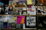 Employee Emily Harnsberger (cq), waits for customers on a slow afternoon at Wax Trax on January...