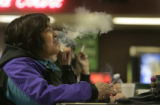 Shirley Marquez, 46 (cq) of Denver takes a long puff of her cigarette and exhales.  If they banned...