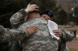 Outside the Soldier's Memorial Chapel, Spc Steven DeFino (cq) of Echo 1-68 weeps and is comforted...