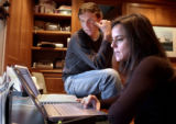 (BOULDER., Colo., Feb. 14, 2006) Tyler Hamilton and his wife Haven Hamilton sits and read...