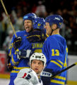 Team U.S.A.'s Darian Hatcher (#2) looks back to see a replay of Team Sweden's game-winning goal by...