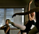 Samantha Buck (cq), 13, of Denver stretches before she and dozens of local youngsters audition for...