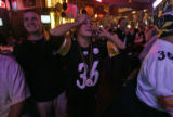 Pittsburgh Steelers fans Nicole Edmondson (cq), left, with her boyfriend Jason Lobb (cq), left, ...