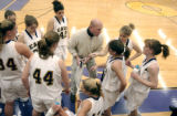 Eads High School basketball coach Shawn Randel (cq) talks to his players  during a game against...