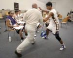 Eads High School basketball coach Shawn Randel (cq) instructs player Sanket Merchant (cq) during a...