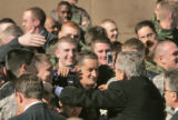 In Aurora, President George W. Bush takes time to greet military personel who are all stationed at...