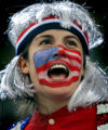 U.S. Women's Hockey Team fan Sally Maloney (cq), 27, of Boston, Ma. cheers as the U.S. Team is...