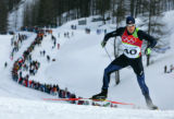 Chris Cook, of the USA, climbs a hill in the men's cross-country sprint qualifier at the 2006...