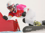 Rosey Fletcher, of the USA, hits a gate in the 1/8 Finals of the Ladies' Parallel Giant Slalom...