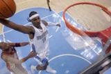 Denver Nuggets forward Carmelo Anthony,right, drives past Cleveland Cavaliers forward Donhyell...