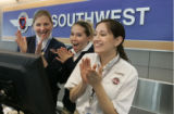 Southwest customer service agents (L-R) Heidi Feldwisch (cq) Erin Sims (cq) and Angela Mcwhorter...