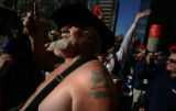 "The tattooed Broncos ""Barrel Man"" Tim McKernan, cq, leads nearly two hundred fans up and..."