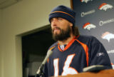 Broncos quarterback Jane Plummer speak to the media at a press conference about the upcoming AFC...