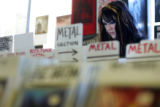 Chrissy Berger, 17, (cq), of Denver, looks for cd's to buy at Wax Trax on Tuesday, January 31,...