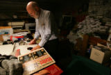Duane Davis (cq), co-owner of Wax Trax, puts away a Beatles album in the store basement after...
