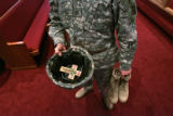 In the Soldier's Memorial Chapel, Staff Sarg. Timothy  McCartney, (cq) carries the helmet which...