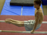 (Wheat Ridge, Colo., June 11, 2004)  Sasha Artemev practices on  the parallel bars at 5280...