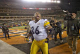Steelers Jerome Bettis screams to the fans as he exits the field after defeating Cincinnati on...