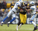 1/1/2006  PITTSBURGH :    Pittsburgh Steelers Jerome Bettis is hauled down by the Lions (28) Bracy...