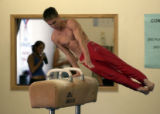 (Wheat Ridge, Colo., June 11, 2004)  Sasha Artemev practices on the pommel horse  at 5280...