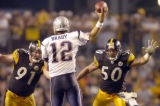 09/25/05-Patriots quarterback Tom Brady is able to get a throw between Steelers Aaron Smith and...