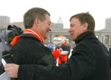Colorado Governor Bill Owens, left and Denver Mayor John Hickenlooper join Miles the Mascot,...