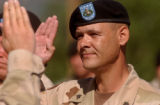 Fort Carson, Colo.-June10, 2004- Sgt. David Cramer re-enlists for four more years in the Army  at...