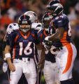 Broncos running back Mike Anderson, center, is joined by quarterback Jake Plummer, left and tight...