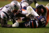 Game action in the 4th quarter of the Denver Broncos against the New England Patriots at Invesco...