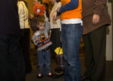 **1/19/06** Philip Reitzig, 5, of Denver plays with a toy firefighter hat and stands among the...