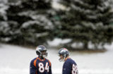 Denver Broncos' tight ends Wesley Duke (#84) and Jeb Putzier (#88) wait for practice to begin...