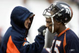 Denver Broncos' wide receiver Ashley Lelie (#85) gets some eye-black applied before practice by a...