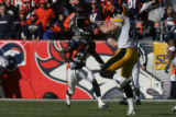 1326 Steelers #83 Heath Miller makes a reception in front of Broncos # 25 Nick Ferguson during the...