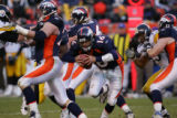 1777 DENVER QB #16 Jake Plummer scrambles in the backfield after the pocket collapsed late in the...