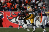1327 Pittsburgh Steelers tight end Heath Miller maneuvers toward Denver's Nick Ferguson during the...