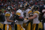 2134 Steelers quarterback #7 Ben Roethlisberger celebrates with the offense after he ran the ball...