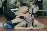 Lafayette, CO Jan. 20, 2006 Quinten Fuentes of Roosevelt trys to roll David Shawcroft of Pueblo...