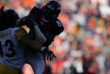 249 Broncos #80 Rod Smith hauls in a pass against Steelers #43 Troy Polamalu during the third...