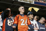 Broncos fans Zach Hansen, cq, left, and his brother Josh Hansen, cq, show dejection after a...